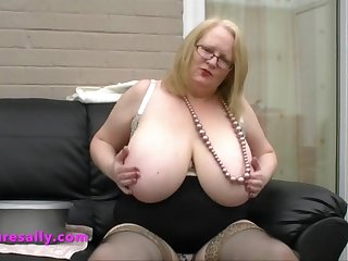 a lovely big cleavage and big tits on this old woman